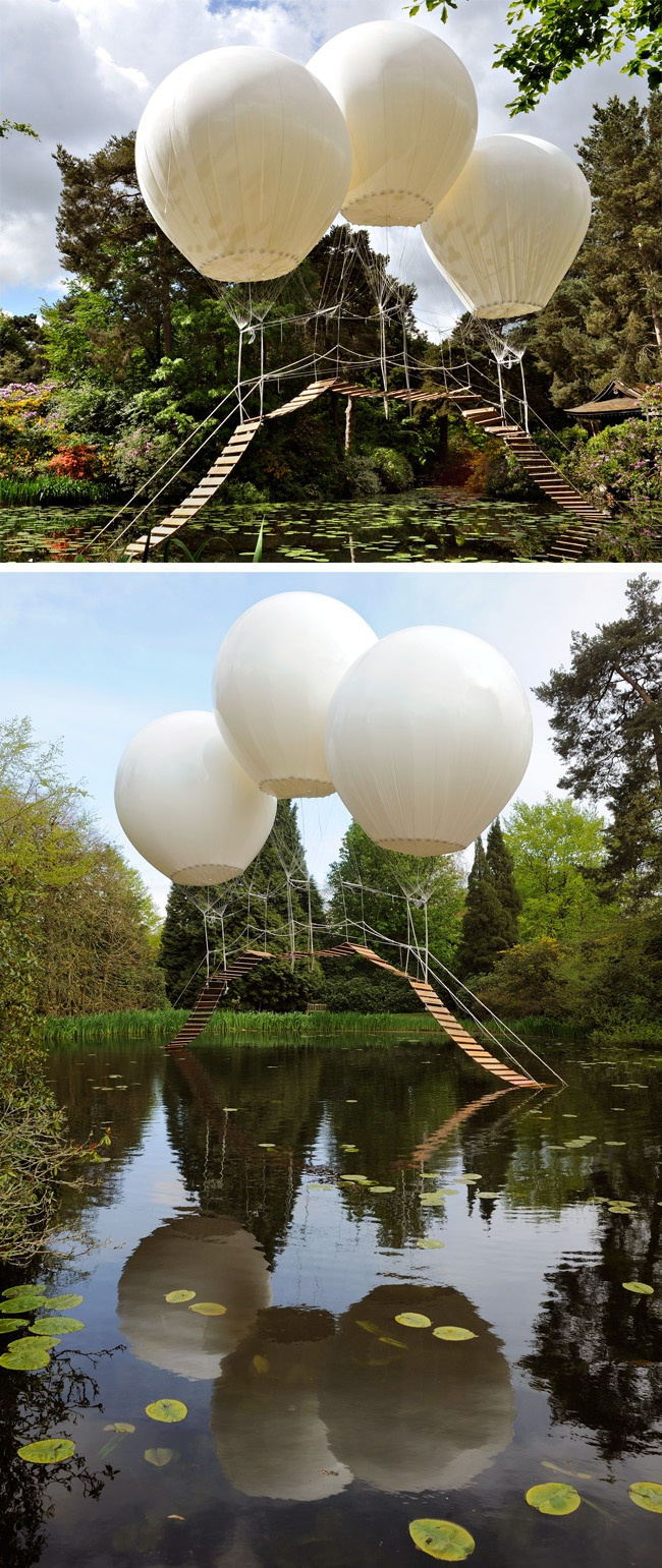 Surreal installation of a feather weight bridge suspended by three helium-filled balloons. By Olivier Grossetete at Tatton's Japanese Garden, UK