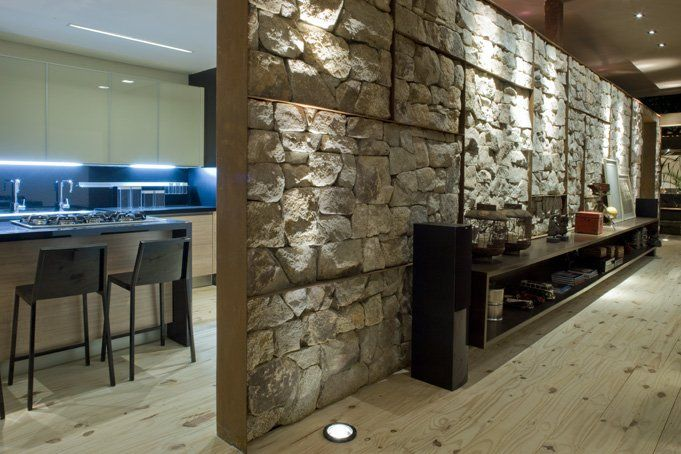 Stone wall, wooden floor, modern kitchen