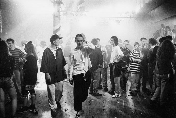 People leaving the dancefloor at the Hacienda on the night of the club's eighth birthday party, Manchester, 1990.