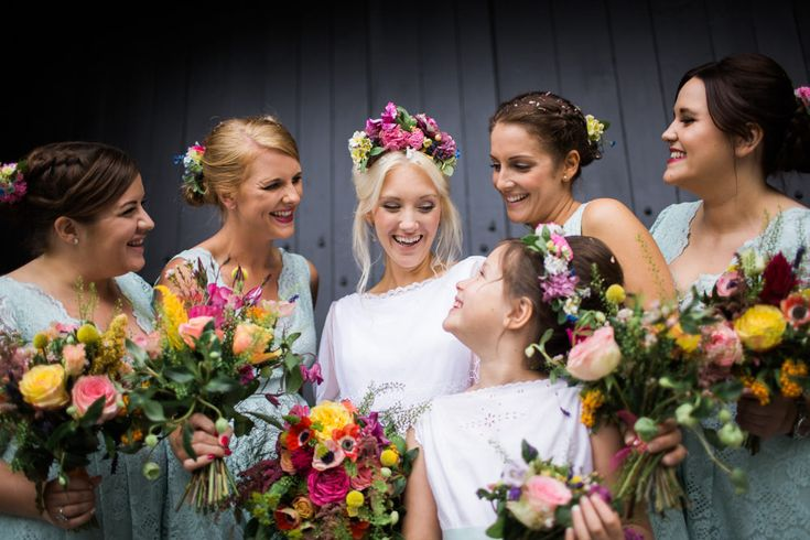 East Riddlesden Hall barn wedding venue in Yorkshire with a vintage dress, colour pop florals and BHS Bridal bridesmaid dresses by Joe Stenson Photography