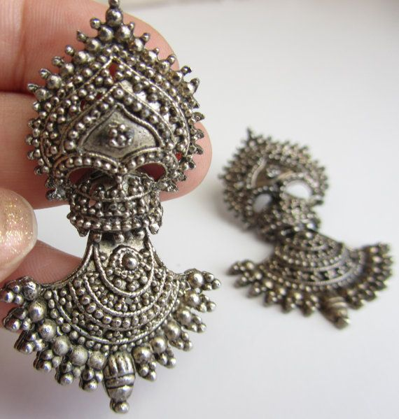 Vintage tribal striking silver Statement jhumka earrings from Rajasthan, India. The listing is for a pair of silver (german silver not sterling) dangly statement earrings from Rajasthan, India. It has no markings consistent with most pieces of it's type made in India before the 1970s. The earrings are for striking & gorgeous, perfect for any occasion. Check out my store for more jewels! https://www.etsy.com/shop/ShopLuxmeJewels https://www.facebook.com/LuxmeJewels