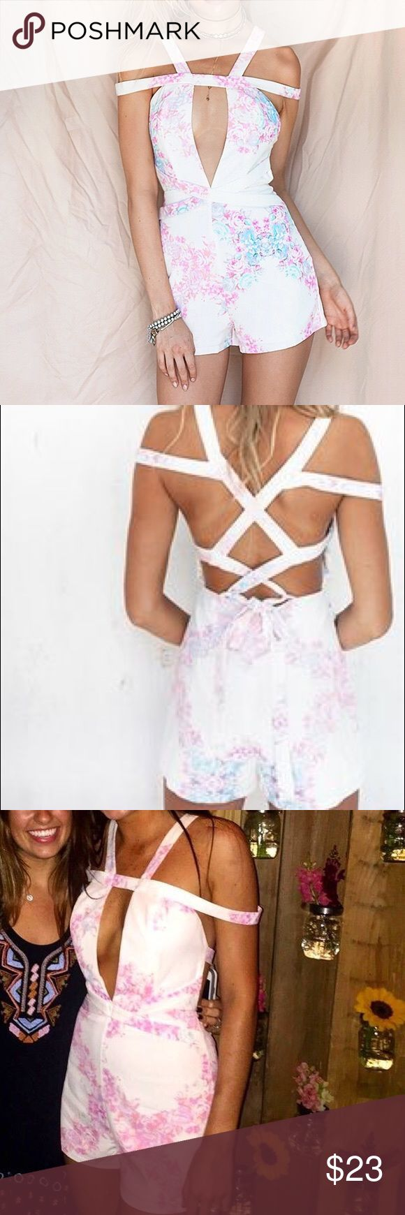"""Sabo Skirt Playsuit Sabo Skirt Ada Bloom Playsuit Super cute and unique playsuit! Only worn twice and in perfect condition! • White with light pink and a little light blue floral details • Strappy back • I am 5' 5"""" 120 lbs and it fit me perfectly Sabo Skirt Other"""