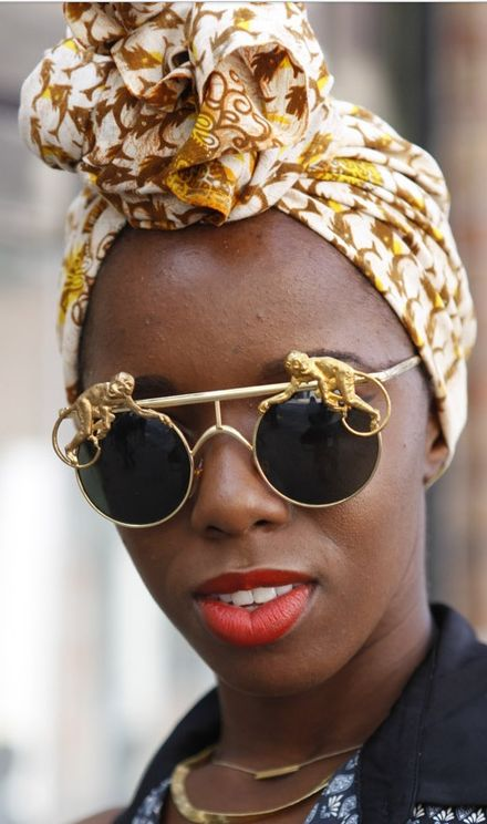 Fun sunglasses - Street Style Mercedes-Benz Fashion Week, NY, S/S 2013 photographed by Luca Lazzari. via Vogue