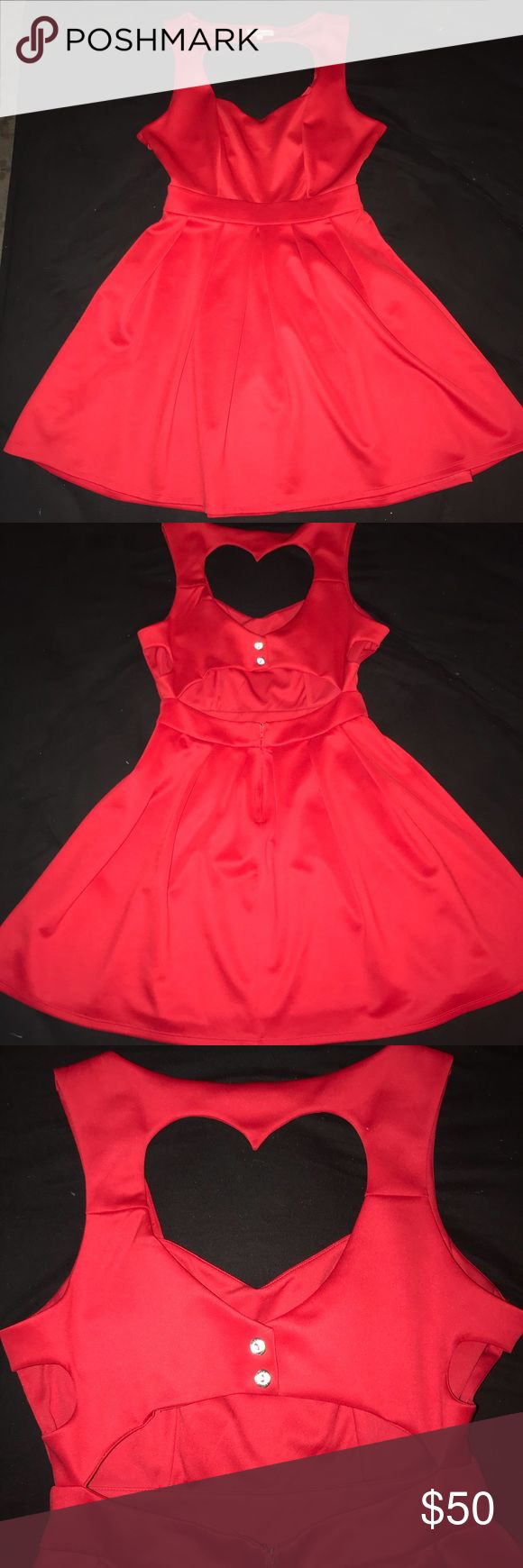 Red cutouts heart back dress Beautiful red dress that is fitted and at the waist is falls with nice pleating. There is a heart cutout on the back, another cutout under the heart, as well as cutouts on the sides. A must have! Charlotte Russe Dresses Midi