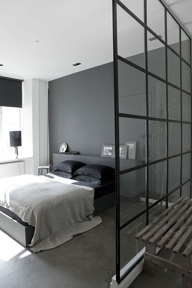 Elegant grey bedroom | love the built-in bedhead + metal and glass divider with bathroom