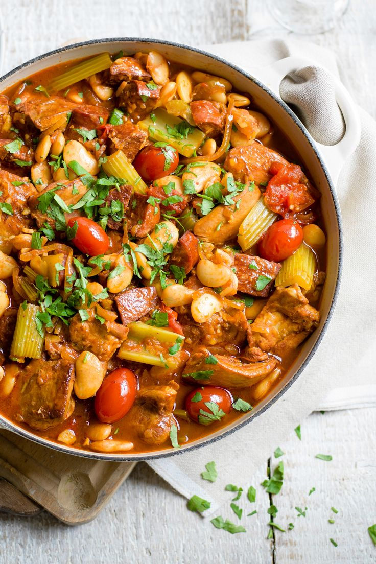 Cooked in a rich tomato sauce with sweet paprika and smoky chorizo, this easy slow cooker chicken casserole recipe is a perfect dish to feed the family. It's cooked with butter beans, so all you need to serve it with is a little crusty bread for dunking. | Tesco