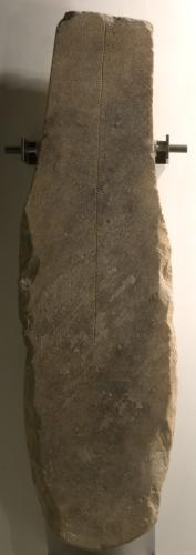 Monumental stone of brownish sandstone with ogham inscription, from Lunnasting, Shetland