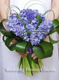 Love this Hyacinth in a bridal bouquet, it looks simple and smells amazing!  The addition of the lily grass certainly sets it apart and gives the bouquet a personality of its own...