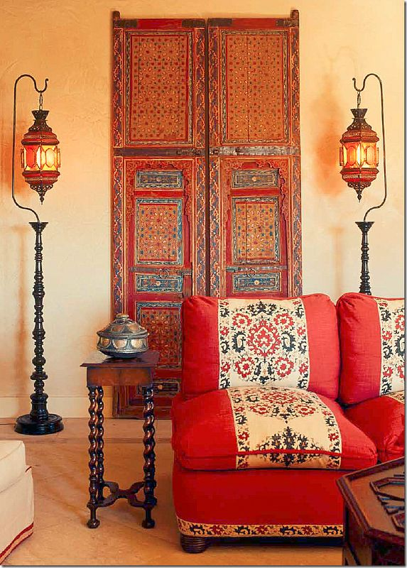 Moroccan doors, Syrian lanterns - cute BT side table, Love the door and the wonderful color of the loveseat.