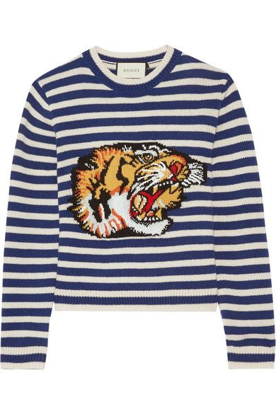 Animal motifs are seen throughout Gucci's eccentric Resort '17 collection. This intarsia sweater is knitted from blue and white striped wool and patterned with a roaring tiger head - a symbol from the brand's archives. It has a comfortable loose fit and crew neckline.