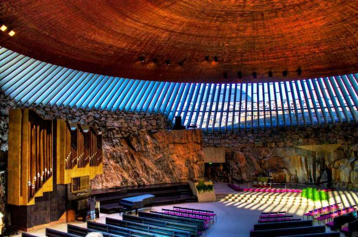 Excavated in 1968, the interior of Finland's fantastic rock church boasts fine acoustics and natural lights streaming through its glazed dome.