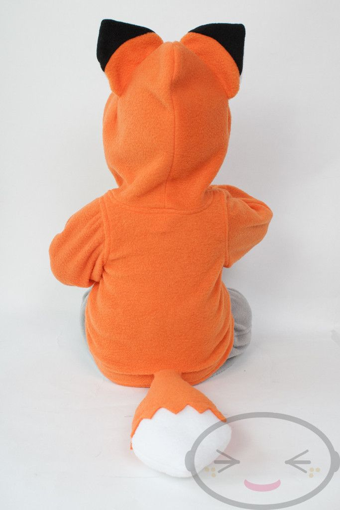 Foxy! Be mischievous, be sly, be foxy with this awesome orange kitsune / fox hoodie!  Each hoodie is made in a comfy fleece. It's a pull-over, with an adorable front pocket!  Please double-check our size charts to make sure you are getting the proper size! We offer detailed measurements to make sure you are getting the most comfortable size for your baby! There is a 20% re-stocking fee for size exchanges. SIZES: 3M - 4T unisex hoodie (see size charts) MATERIALS: Fleece SLEEVE OPTIONS: Our…
