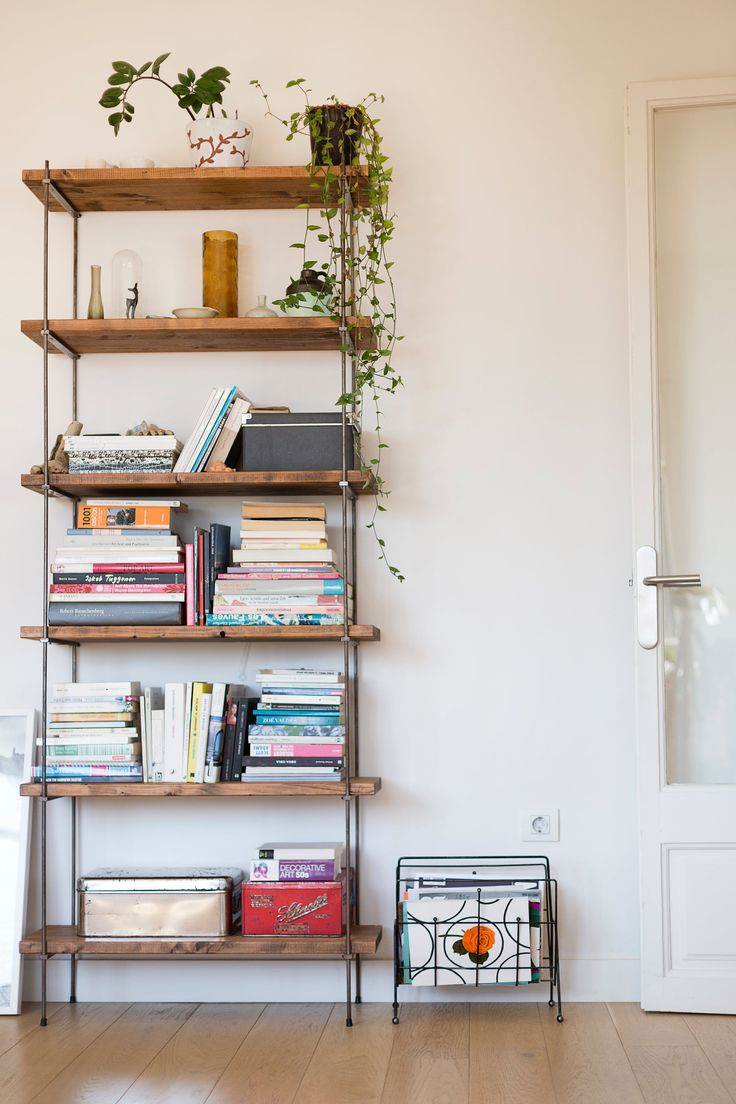 The handmade bookshelves add a touch of industrial materials to the space.