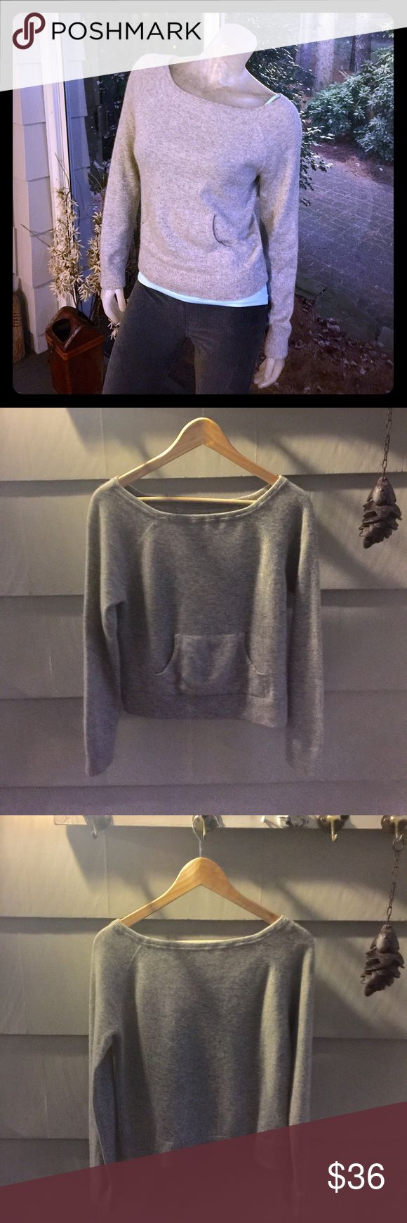Express 100% Cashmere Crop Sweater Heather Gray 100% Cashmere Baotneck style Sweater with kangaroo pouch is warm and soft and in very good pre-owned condition. No issues except I removed the Express tag because it bothered me. Size Small/Medium 2, 4, 6 best fit. No trades, please. Will soon add better daylight pics. Express Sweaters Crew & Scoop Necks