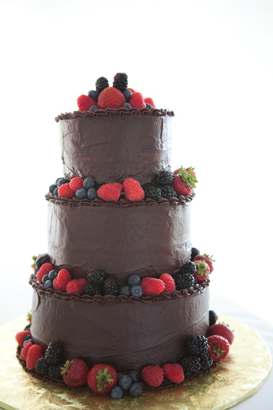 chocolate wedding cake with berries, on holden pond wedding. www.artistrieco.com