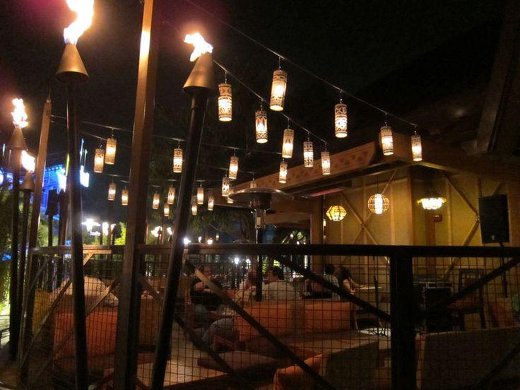 Outdoor patio at night at Trader Sam's Enchanted Tiki Bar ...