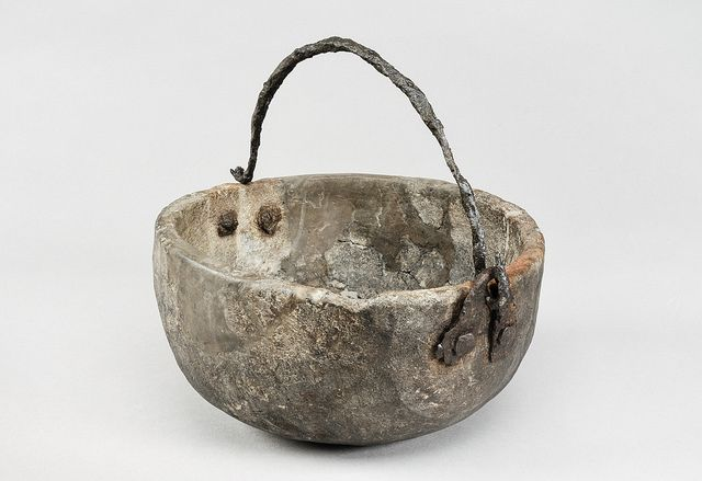 Hanging vessel from the Viking age. Soap stone and iron. Grave find Björkö, Sweden. Object from the exhibition