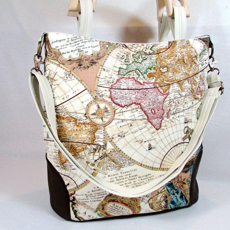 Klára cesta kolem světa kabelka,kabela,taška pro všestranné využití do práce,do školy na výlet ušitá z krásné bavlněné látka s krásným motivem mapy světa spodní oválný díl a všité spodní díly jsou z koženky čokoládové barvy,zadní díl béžová koženka taška má jednoduchý tvar vyztužená ronarem zipové zapínání tašku zdobí dřevěná ucha dělaná v ...