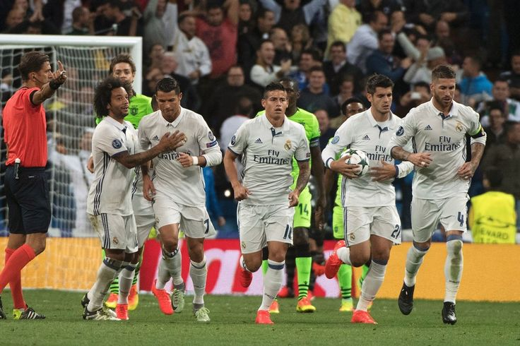 Real Madrid's Portuguese forward Cristiano Ronaldo celebrates with his teammates after scoring during the UEFA Champions League football match Real Madrid CF vs Sporting CP at the Santiago Bernabeu stadium in Madrid on September 14, 2016.