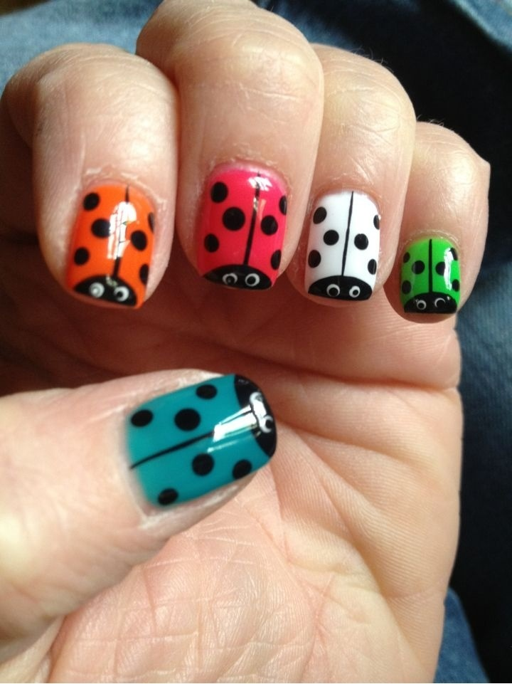 Too cute! Idea: Paint all nails except left ring finger and right index a foliage green. Paint ring & index fingers red and paint lady bug design on them - mani I am doing now will post pics.