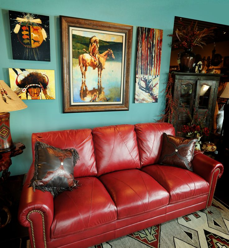 Bold colored wall with red couch.  Artwork ties colors together.