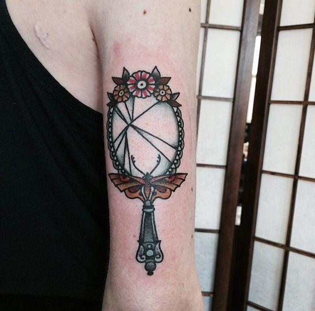 Beautiful traditional mirror tattoo.