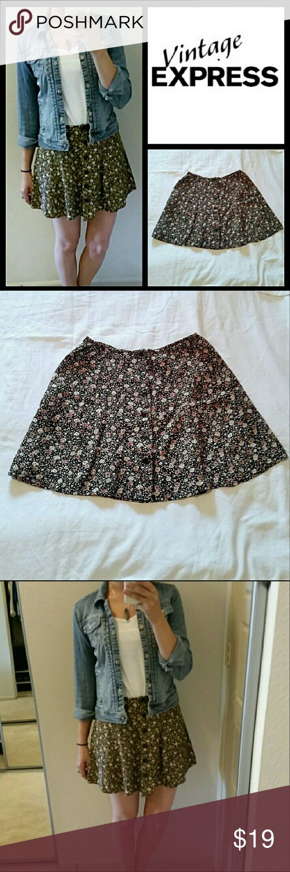 Vintage floral skirt Beautiful black floral button up skirt from Express. Like new condition! This quality cotton skirt is vintage express from the 90's and is so in style today! I purchased on etsy for $48 & unfortunately it's just not the right size for me. Near perfect condition. Photos do not do justice. Tag reads 7/8, reads TTS for a medium.  Check out my closet for more great items! Bundle discount available! Skirts