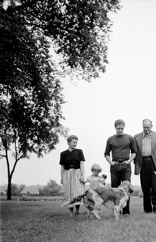 Marlon Brando photographed by Art Shay with his sister Frances Brando, niece and father Marlon Brando Sr. during a visit, Libertyville, Illinois ~ 1951