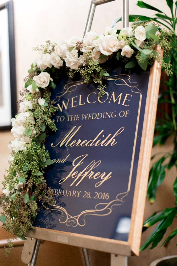 Gorgeous wedding ceremony sign with flowers (Photo by Arte De Vie)