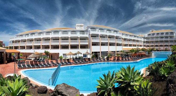 Apartamentos Marola-Portosin Playa de las Americas This apartment complex is located just a short stroll from the beach in Playa de las Americas, in the south of the island of Tenerife.  Spend the day in Apartamentos Marola-Portosin relaxing by the large outdoor swimming pool in the summer.