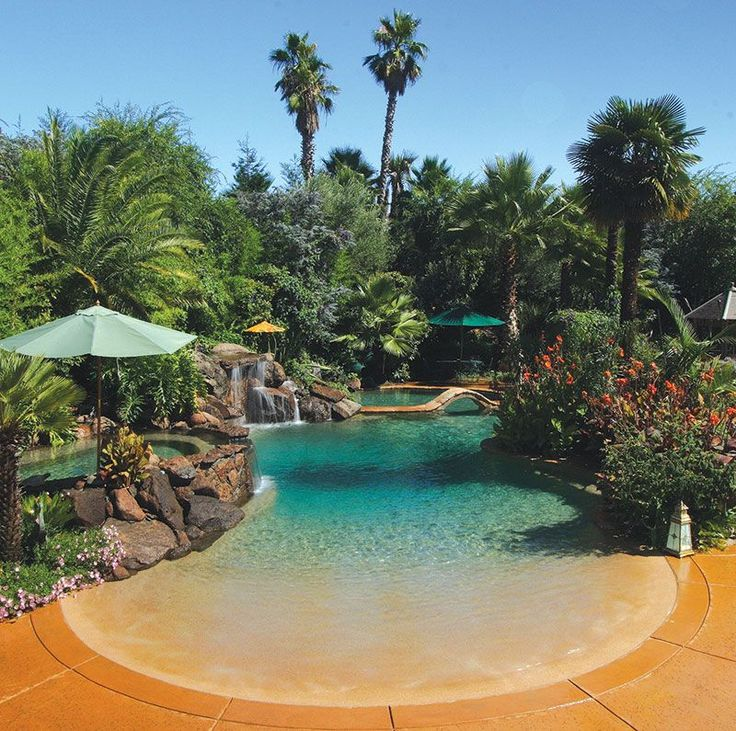 Residential beach entry tropical pool with rock waterfalls and palm trees by Advanced Pools, Rancho Cordova, CA. Via ~LadyLuxury~