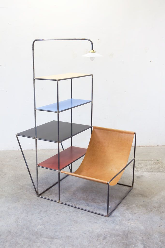 Zitrek2 by muller van severan. When loaded with books, this piece could serve as a small room divider with a reading nook on one side and a small table on the other