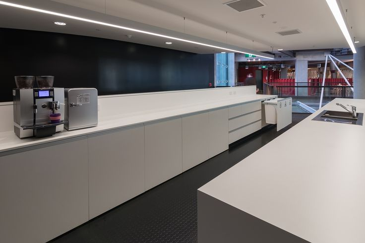 A functional, modern kitchen with a recycling system integrated seamlessly into the kitchen design. 50L Hideaway Bins are installed side by side keeping waste hidden away, adding to the aesthetic appeal of the environment.  Acknowledgements: ASB Bank. Cabinets designed by Sage Manufacturing.