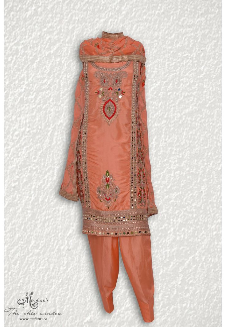 Ethnic peach suit adorn in traditional mirror and tilla work