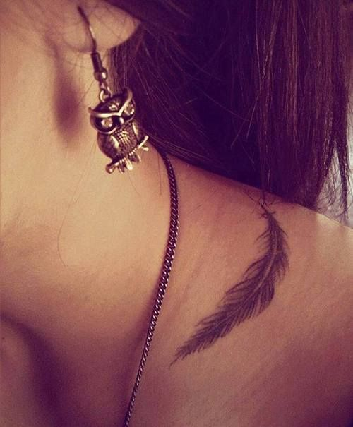 Little neck tattoo of a feather.