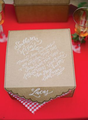 amazing gourmet picnic boxes with the menu hand-lettered by Lindsay Letters on top | Eric Kelley
