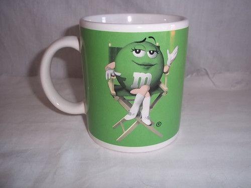 Green M's Lady Coffee Mug Two Poses 10 ounces  http://www.ebay.com/itm/Green-M-Ms-Lady-Coffee-Mug-Two-Poses-10-ounces-/151102393660?pt=LH_DefaultDomain_0=item232e678d3c