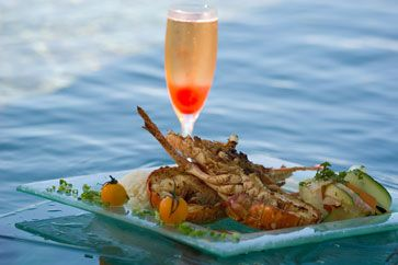 Tamaa maitai! The chef at the InterContinental Moorea Resort's restaurant, Fare Nui, is known for the delicate blending of French cuisine with exotic local flavours to create three-course feasts as unforgettable as the setting.  #Jetsetter #JSBeachDining Jetsetter.com