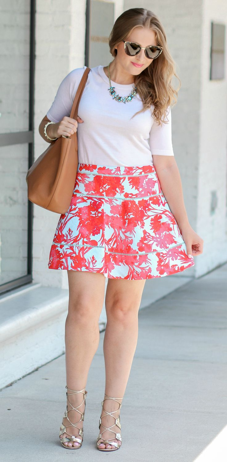 So, so adorable! Such a cute outfit idea! Banana Republic flare skirt, gold lace-up heels, Quay My Girl Sunglasses, and Tory Burch Perry Tote. The perfect spring outfit idea! || Click through this pin to see the full look from style blogger Ashley Brooke Nicholas