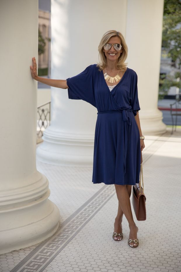Check out our Navy jersey faux wrap dress and gold tone statement necklace both available in our shop www.jacketsociety.com