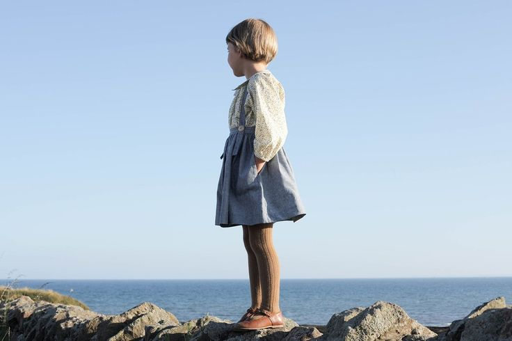 Soor Ploom classic schoolgirl skirt with suspenders. Elastic at back waistband, adjustable wood buttons at front straps. Side pockets, straps criss-cross at back. Skirt falls just above the knee. 70%