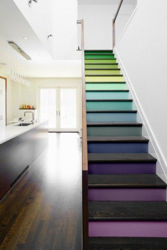 This dark wooden floor provides the perfect backdrop to the multicoloured stairs.