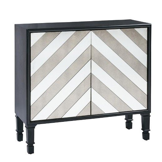 Redefine contemporary style with this Nora Chevron Mirror Accent Chest. With an artist's eye, this piece skillfully mixes modern with rustic, elegant with casual, and romantic with relaxed. No assembly required