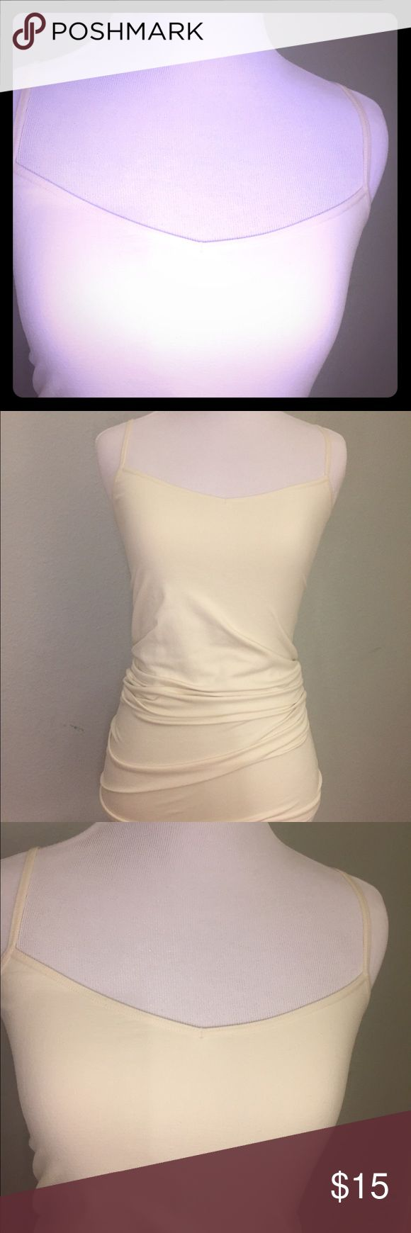 """Free People cream tank Intimately Free People basic cami. It's sized M/L. It's a cream/white color. Straps are adjustable. It's too long on me, I'm 5'1"""" and it looked like a Mariah Carey 90's dress, so here it is! Free People Tops Tank Tops"""