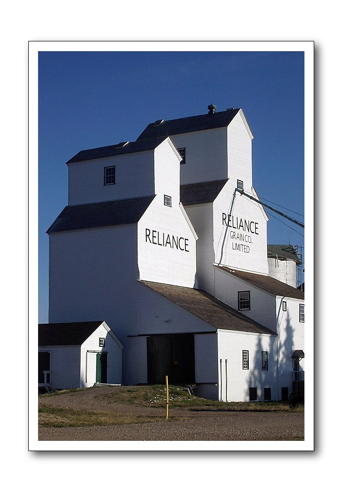 The double Reliance elevators in the row of vintage grain elevators at Inglis, Manitoba, Canada