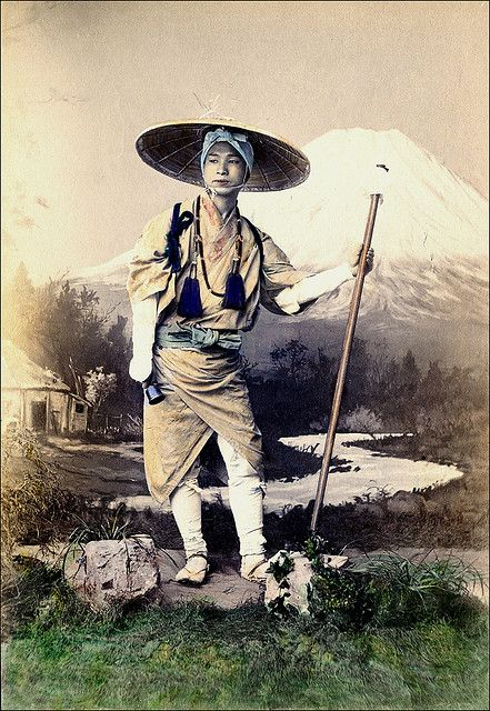 Japanese Pilgrim--A staged 10th century photography of a pilgrim in traditional wear.  Handcolored photograph.