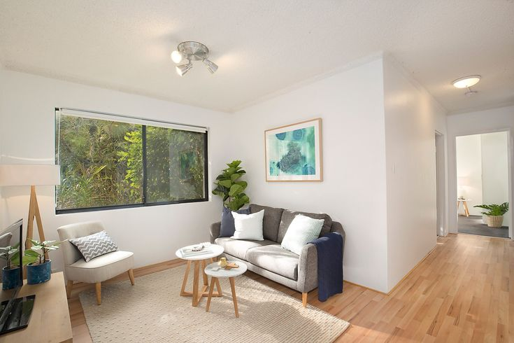 'Harbour Views' apartment with parking, open plan living, timber floors, styled, wall art, leafy outlook, floor lamp, coffee tables, sitting chair, throw cushions, Pilcher Residential