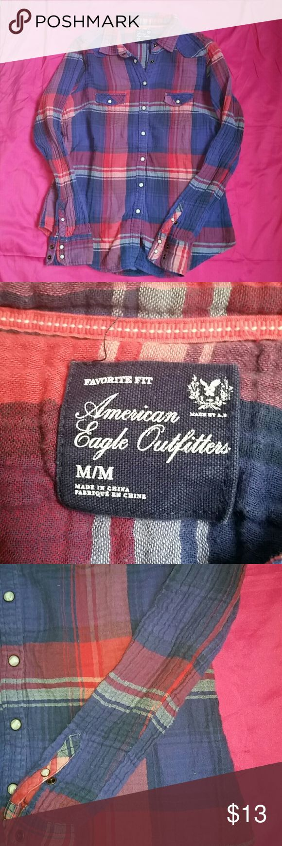 """American Eagle Outfitters size M """"flannel """" American Eagle Outfitters size M """"flannel"""" like shirt. """"Favorite Fit """". Shirt snaps down the front. Sleeves have a wrinkled look. American Eagle Outfitters Tops Button Down Shirts"""