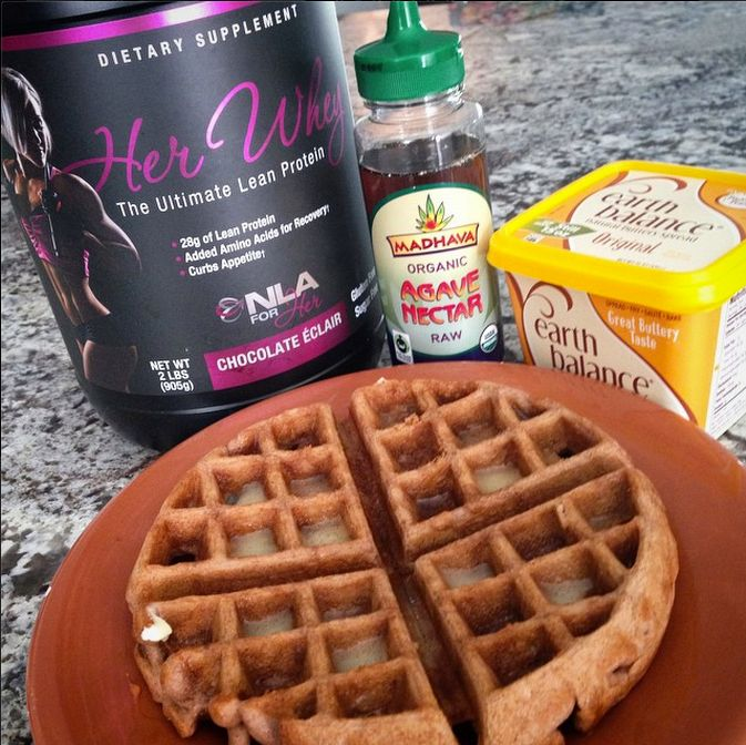 My sweets craving waffle fix: 1 scoop Chocolate Eclair protein from NLA for Her Her Whey (jessiefit.com/herwhey), 1/2 cup rolled oats blended fine, 1/2 cup egg whites, 1/4 cup Greek yogurt (cottage cheese works, too), and 1 tsp baking powder (made 2 waffles). I needed some extra love this morning so I used my Earth Balance butter and raw Agave as a topping   Jessie Hilgenberg fb post