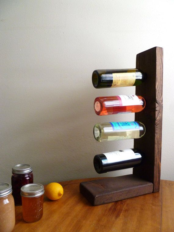 Hey, I found this really awesome Etsy listing at https://www.etsy.com/listing/176789375/balancing-wine-rack-four-bottle-custom
